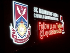 Loyola EMC Sign at Night