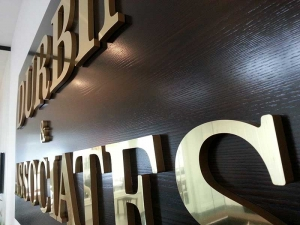Raised golden lettering reception sign
