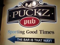 Puckz Pub wall sign