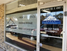 logo and lettering window sign