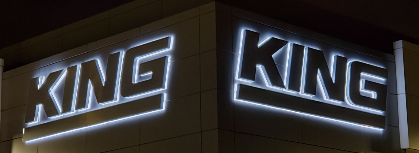 https://www.aboutsigns.ca/wp-content/uploads/2020/12/halo-lit-back-lit-king-sign-about-signs-hero-1.jpg